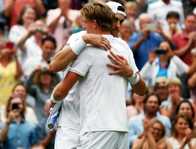 South Africa's Kevin Anderson hugs USA's John Isner after their Wimbledon men's singles semi-final. The match lasted six hours and 36 minutes