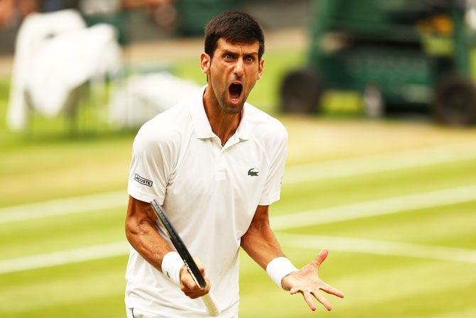 Novak Djokovic reacts during the 2018 Wimbledon semi-final against Rafael Nadal