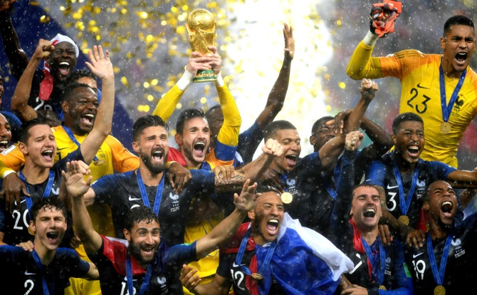 Hugo Lloris of France lifts the World Cup trophy to celebrate with his teammates after the 2018 FIFA World Cup Final