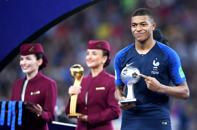 France's Kylian Mbappe receives the Best Young Player award