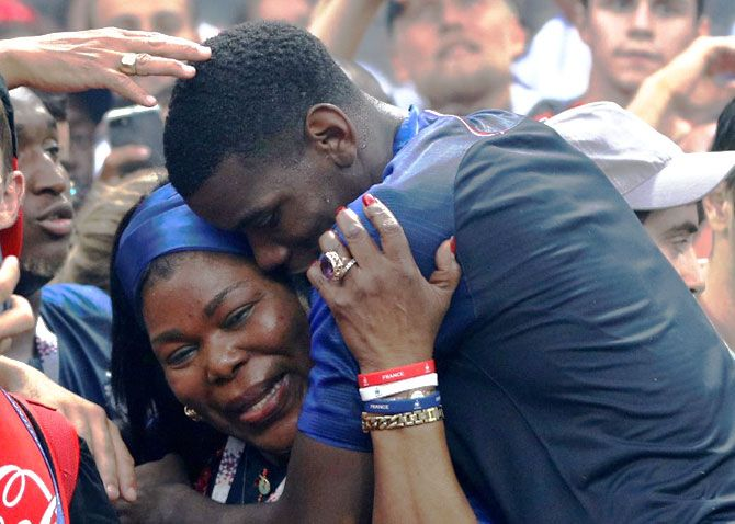 France's Paul Pogba celebrates with mother Yeo Pogba