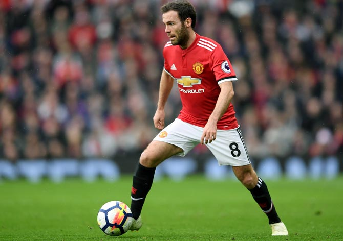 Manchester United's Mata keen to end Spain exile under Enrique