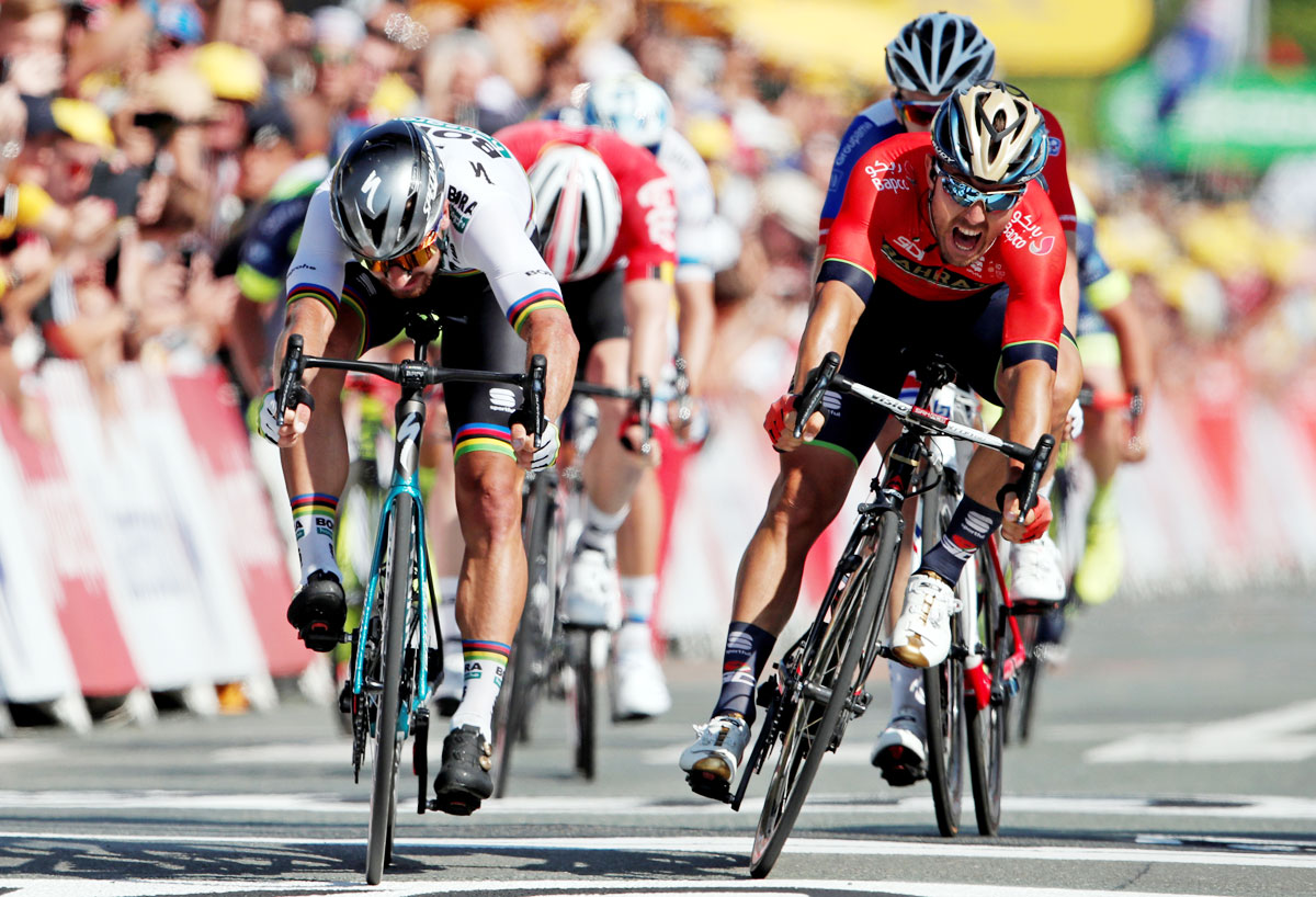 BORA-Hansgrohe rider Peter Sagan of Slovakia and Bahrain-Merida rider Sonny Colbrelli of Italy battle it out at the 182.5-km Stage 2 from Mouilleron-Saint-Germain to La Roche-sur-Yon on July 8