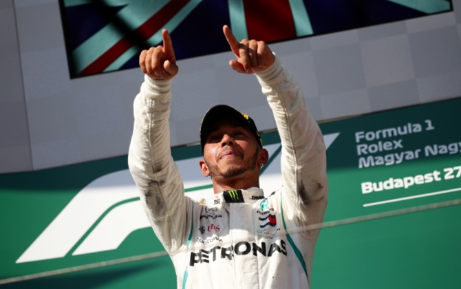 Rediff Sports - Cricket, Indian hockey, Tennis, Football, Chess, Golf - Hamilton wins in Hungary to stretch F1 title lead