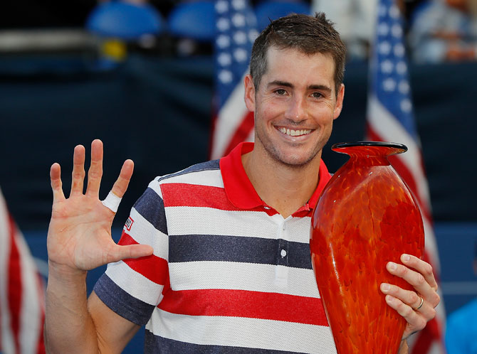 America's John Isner poses with the trophy after defeating Ryan Harrison during the BB&T Atlanta Open at Atlantic Station in Atlanta, Georgia, on Sunday