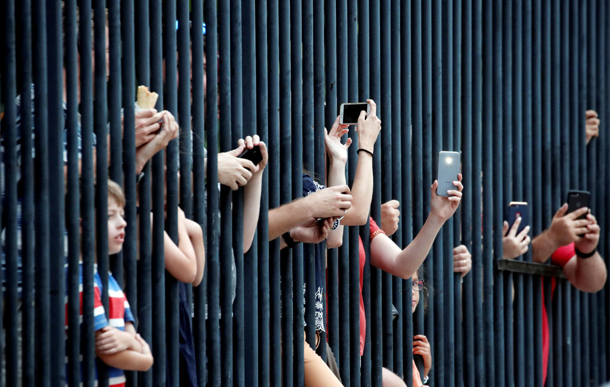 Fans watch the final stage of the Tour de France on Sunday