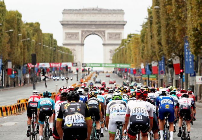 The peloton races towards the Arc de Triomphe on the final stretch of the 116-km Stage 21 from Houilles to Paris Champs-Elysees at Tour de France on Sunday