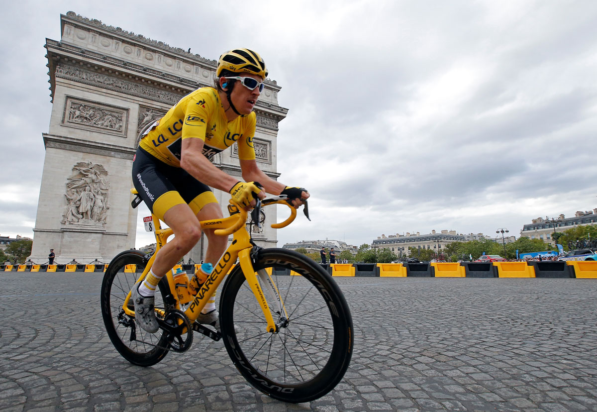 Team Sky rider Geraint Thomas of Britain, wearing the overall leader's yellow jersey, passes the Arc de Triomphe at the 116-km Stage 21 from Houilles to Paris Champs-Elysees on Sunday