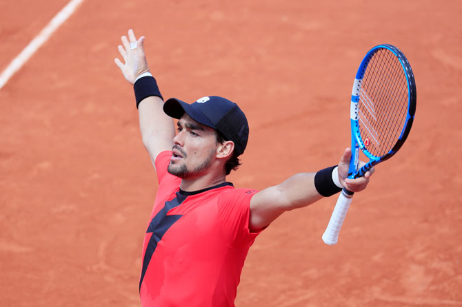 Italy's Fabio Fognini celebrates after winning his third round match against Britain's Kyle Edmund