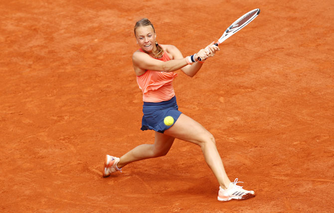 Estonia's Anett Kontaveit plays a backhand during her third round match against Czech Republic's Petra Kvitova