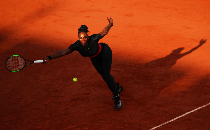 USA's Serena Williams plays a forehand return during her third round match against Germany's Julia Georges