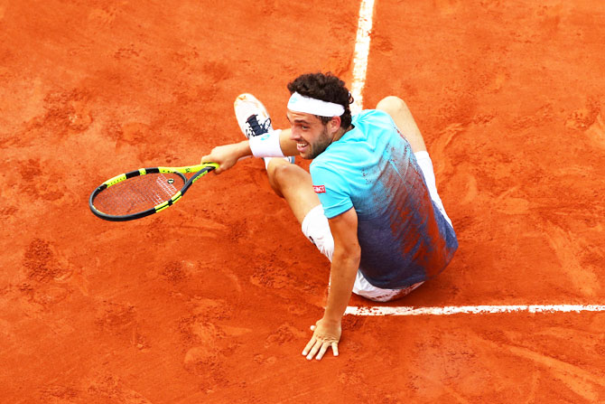 Italy's Marco Cecchinato celebrates his fourth round victory over Belgium's David Goffin on Sunday