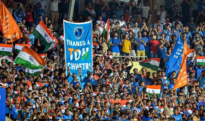 Indian football fans cheer on the team