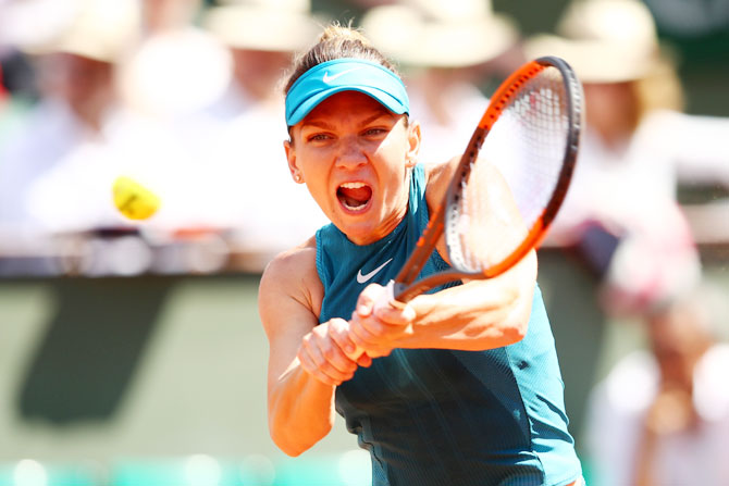 Romania's Simona Halep plays a backhand during the ladies singles semi-final match agianst Spain's Garbine Murguruza