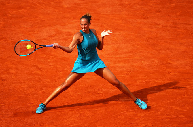 Madison Keys plays a return against Sloane Stephens