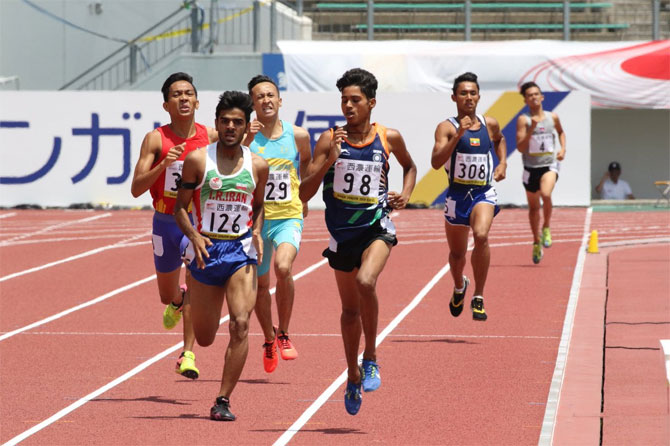 India's Anu Kumar edges Iran's Abdolrahim Dorzadeh to claim the 800 metres gold at the Asian Junior Athletics Championships in Japan on Saturday