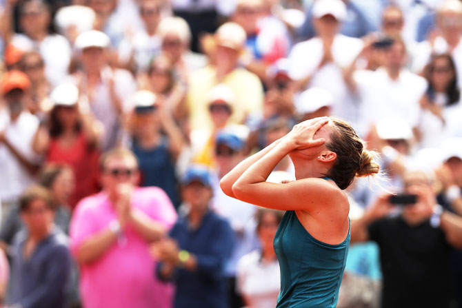 Simona Halep reacts after winning the French Open final, her first Grand Slam title