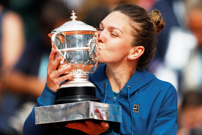 Romania's Simona Halep kisses the trophy after beating USA's Sloane Stephens to win the 2018 French Open final at Roland Garros in Paris on Saturday