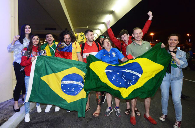 Brazil supporters greet the players on arrival in Sochi on Monday