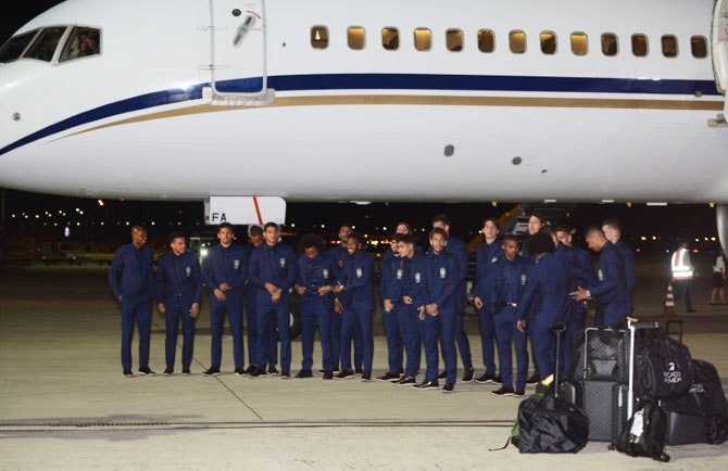 Brazil's players pose near a plane upon the arrival at the Sochi International Airport, Sochi, Russia, on Monday