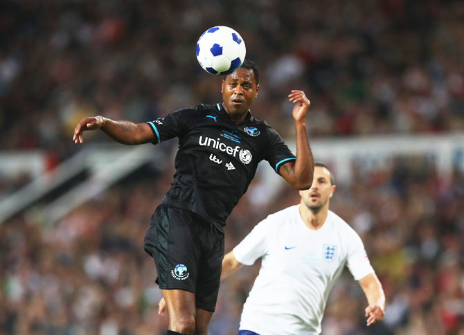 World XI's Patrick Kluivert wins a header during the Soccer Aid for UNICEF 2018 match against England
