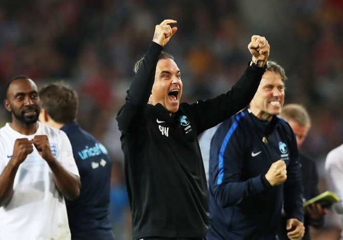 Singer Robbie Williams of England celebrates a successful penalty in the shoot out during the Soccer Aid for UNICEF 2018 match