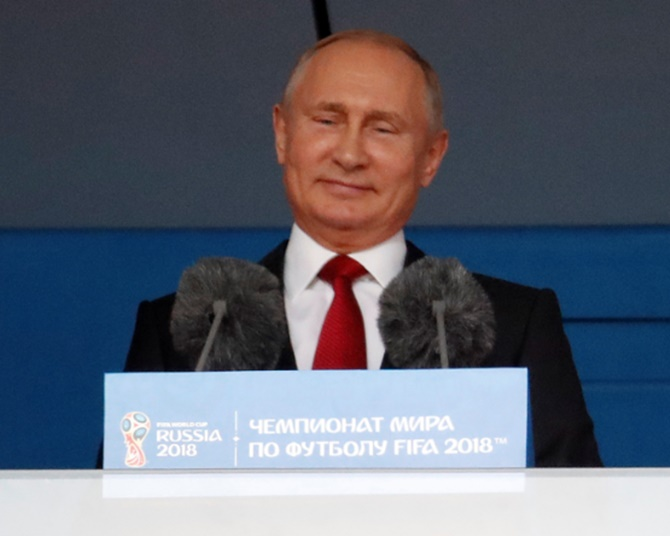 Defiant Putin welcomes World Cup as Russia win