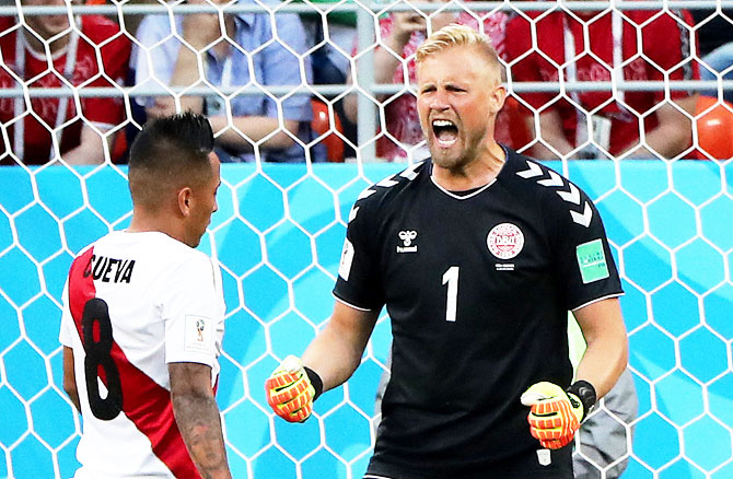 Denmark's Kasper Schmeichel reacts after Peru's Christian Cueva misses a penalty kick