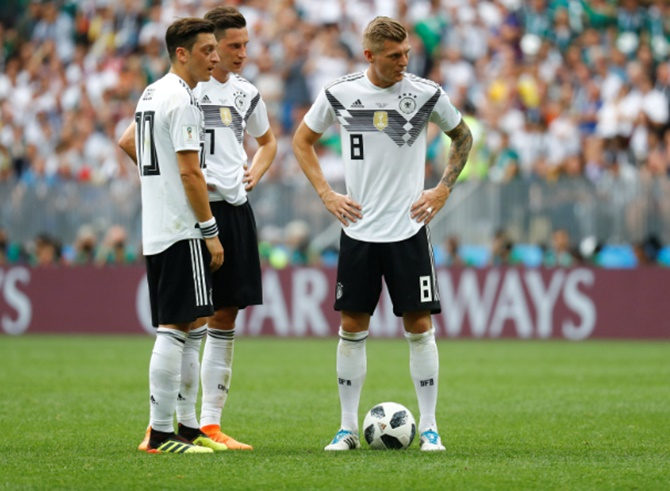Germany's Mesut Ozil, Julian Draxler and Toni Kroos