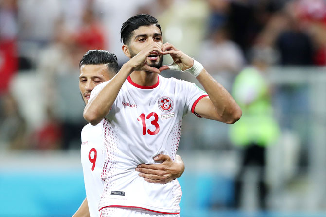 Tunisia's Ferjani Sassi celebrates after scoring his team's first goal against England during their Group G match