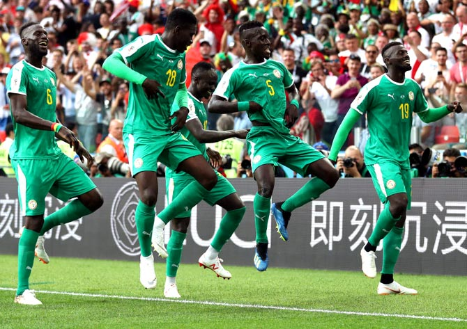 PHOTOS: Poland's mishaps help Senegal claim first African win