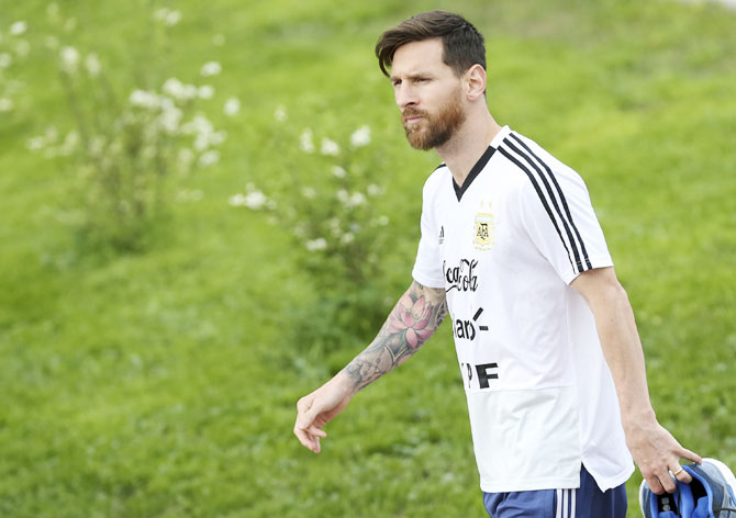 Lionel Messi arrives at a Argentina training session on Tuesday