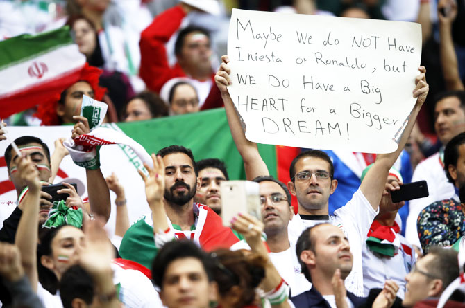 Iran's football supporters speak what's on their mind through this placard during the match against Spain at the Kazan Stadium in Kazan on Wednesday