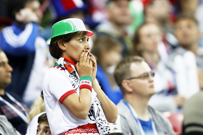 An Iran fan reacts following her team's defeat to Spain on Wednesday