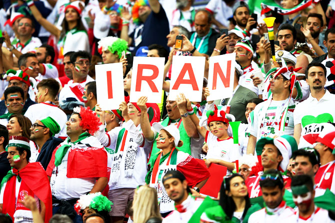 Iranian fans show their support during the match against Spain