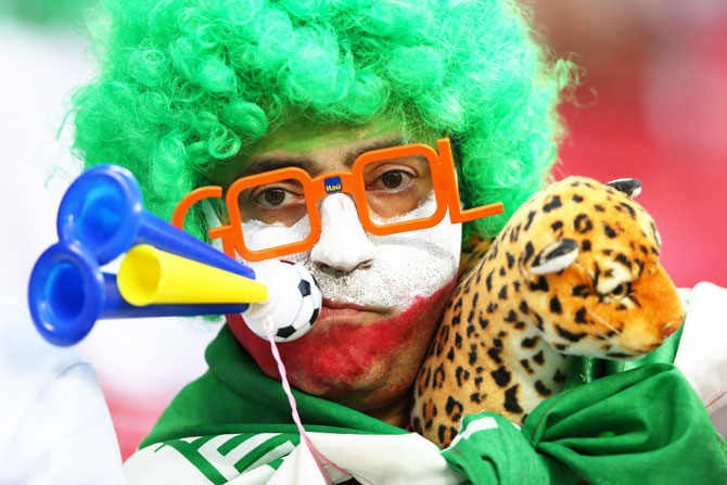 An Iran fan enjoys the pre-match atmosphere outside the Kazan Arena on Wednesday