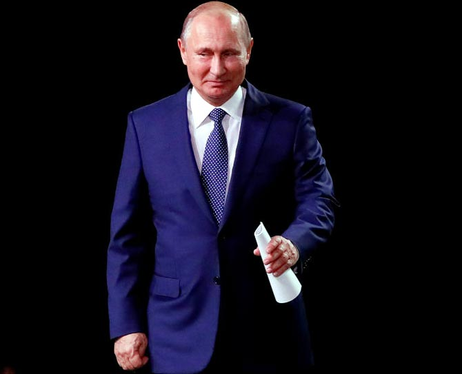 President Putin revels in Russia's unexpected World Cup form