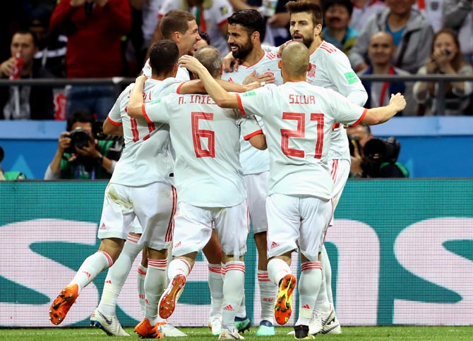 PHOTOS: Spain squeeze past dogged Iran to stay alive