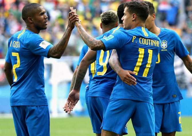 Brazil's players celebrate a goal with Philippe Coutinho