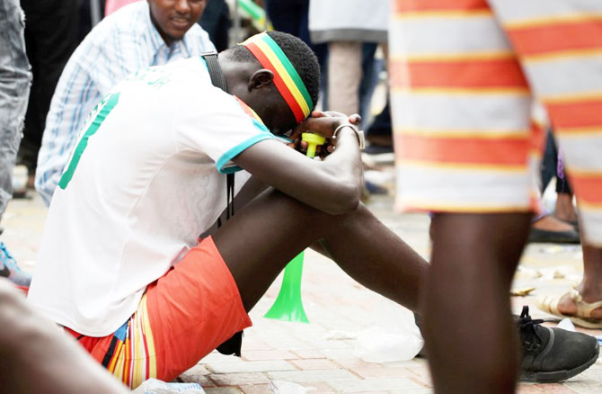 A Sengalese fan reacts after the match against Colombia in Dakar on Thursday