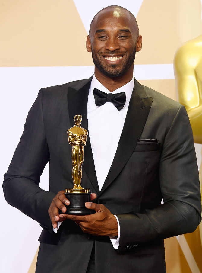 NBA star and filmmaker Kobe Bryant, winner of the Best Animated Short Film award for 'Dear Basketball,' poses in the press room during the 90th Annual Academy Awards at Hollywood & Highland Center in Hollywood, California, on March 4