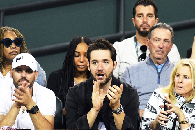 Alexis Ohanian, co-founder and executive chairman of the social news website Reddit, cheers on as his wife Serena Williams plays against Zarina Diyas