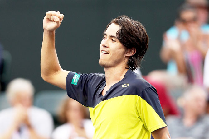 Japan's Taro Daniel celebrates his win over Great Britain's Cameron Noorie during the BNP Paribas Open at the Indian Wells Tennis Garden in Indian Wells, California, on Friday