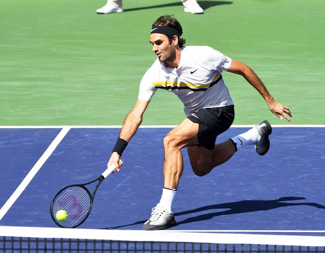 Roger Federer plays a return during his third round match against Filip Krajinovic at the Indian Wells Tennis Garden at Indian Wells in California