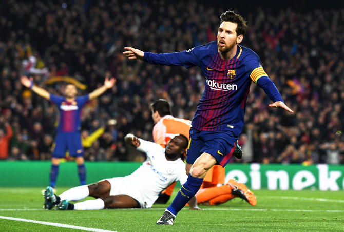 Lionel Messi celebrates on scoring the third goal against Chelsea, his 100th Champions League goal, at Nou Camp in Barcelona on Wednesday, March 14