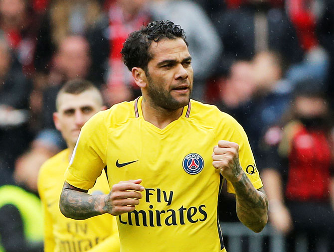 Paris Saint-Germain's Dani Alves celebrates scoring their second goal against OGC Nice during their Ligue 1 match at Allianz Riviera, in Nice on Sunday