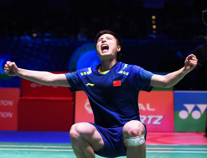 China's Shi Yuqi celebrates after beating China's Lin Dan in the men's singles final the Yonex All England Open Badminton Championships at Arena Birmingham in Birmingham, England, on Sunday