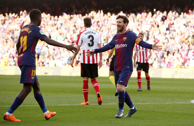 Barcelona's Lionel Messi celebrates with Ousmane Dembele after scoring their second goal against Athletic Bilbao at Camp Nou on Sunday