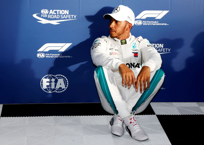 Mercedes' Lewis Hamilton relaxes in the paddock after qualifying on Saturday