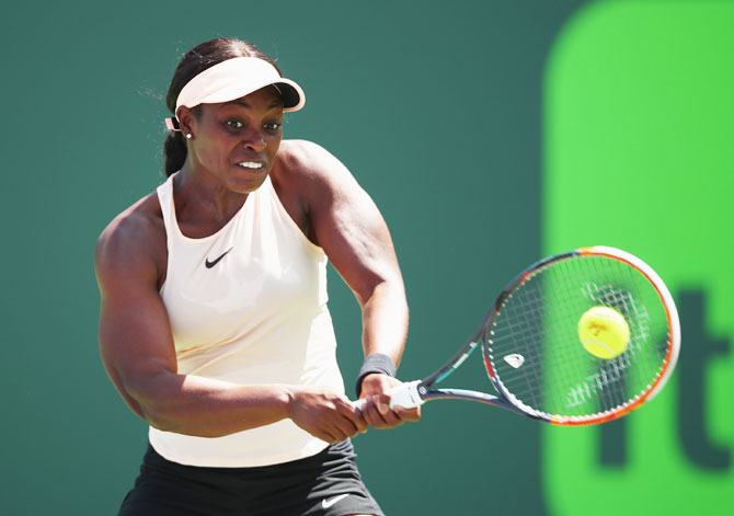 USA's Sloane Stephens plays a backhand against Germany's Angelique Kerber in their fourth round match at Crandon Park Tennis Center